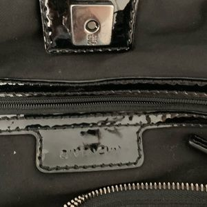 Givenchy Bags - Givenchy black nylon w/leather Sacca bag